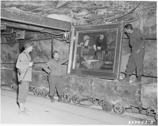 """#American soldiers discover Manet's """"In the Conservatory"""" that was hidden in the salt mines of Merker, Germany. 1945 [2991x2400] #history #retro #vintage #dh #HistoryPorn http://ift.tt/2g7yj54"""
