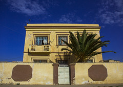 Old Colonial Italian House, Dekemhare, Eritrea (Eric Lafforgue) Tags: africa street color colour building horizontal architecture outdoors photography day colonial nobody nopeople palm decline oldfashioned eritrea hornofafrica eastafrica dekemhare eritreo buildingexterior colorpicture erytrea eritreia colourimage italiancolony  ertra    eritre eritreja eritria colourpicture  rythre africaorientaleitaliana     eritre eritrja  eritreya  erythraa erytreja     decamere colonialitalianarchitecture italiancolonialempire eri5288