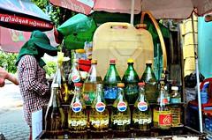 Yellow Pepsi (Pedestrian Photographer) Tags: water june yellow umbrella cambodia khmer cola bottles coke scooter gas motorcycle pepsi petrol cart sell sales coca fuel phnom liter penh liters 2013 dsc7607 dsc7607jpg