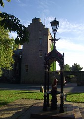 Dornoch Castle  & Fountain in Dornoch Sutherland Scotland (conner395) Tags: scotland highlands alba scottish escocia highland scotia sutherland szkocja caledonia conner esccia schottland schotland ecosse scozia scottishhighlands skottland skotlanti skotland  sutherlandshire   highlandscotland  daveconner conner395  davidconner daveconnerinverness daveconnerinvernessscotland