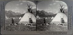 Blackfeet Indians near St. Mary's Lake in Glacier National Park, Montana. (lhboudreau) Tags: historyin3d stereoview stereograph stereoviews stereographs 3d 3dphoto 3dphotos historical history stereocard stereophoto stereoimage indian indians nativeamerican nativeamericans blackfeet blackfoottribe blackfoot glaciernationalpark montana keystoneviewcompany teepee teepees wigwam wigwams stmaryslake americanindians stereocards stereogram stereograms outdoor