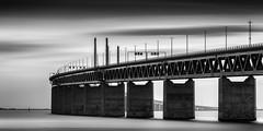 Iron Connection II ~ Öresundsbron (Mabry Campbell) Tags: ocean longexposure bridge sunset sea blackandwhite bw seascape water monochrome photography coast photo skåne europe photographer image suspension fav50 sweden fineart may fav20 explore coastal photograph le 100 sverige scandinavia fav30 malmö f71 suspensionbridge malmo saltwater fineartphotography oresund øresund öresund 200mm öresundsbron architecturalphotography øresundsbron skane commercialphotography fav10 fav100 fav200 explored editorialphotography 2013 fav40 fav60 dissing architecturephotography fav90 ef200mmf28liiusm weitling dissingweitling oresundsbron fav80 fav70 fineartphotographer houstonphotographer dissingandweitling mabrycampbell may302013 1780sec òresund 201305300h6a2628edit2 dissingweitlingarchitecture