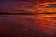 Fire and Sand (howardignatius) Tags: ocean california ca sunset sky beach clouds sand morrobay morrostrand vision:sunset=0916 vision:sky=0796 vision:outdoor=0814 vision:clouds=0832 vision:car=0573 vision:ocean=0576