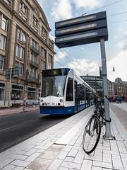 Bike And Tram (spanjavan) Tags: amsterdam thenetherlands tram vr northholland