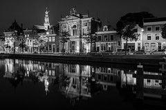 Night Vision (McQuaide Photography) Tags: haarlem noordholland northholland netherlands nederland holland dutch europe sony a7rii ilce7rm2 alpha mirrorless 1635mm sonyzeiss zeiss variotessar fullframe mcquaidephotography adobe photoshop lightroom tripod manfrotto light licht availablelight night nacht nightphotography water calm still reflection longexposure stad city urban river spaarne rivier waterside lowlight outdoor outside waterfront architecture skyline building house huis huizen residential gebouw monochrome mono blackwhite bw blackandwhite classic authentic rijksmonument nationalmonument oldbuilding museum history historic teylersmuseum stbavo spire kerk dewaag