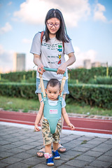 Mother teaching baby boy how to walk (HIKARU Pan) Tags: 1dx 50l asia canonef50mmf12lusm china eos1dx photography portrait shanghai babyboy cute family lovely motherandson outdoors vertical walking youngwoman