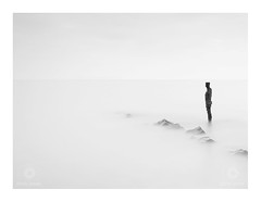 Distance (Chris Jones www.chrisjonesphotographer.uk) Tags: statue black white dorset kimmeridge bay antony gormley sea ocean rocks bw high key jurassic coast coastline metal sculpture chris jones photographer wwwchrisjonesphotographeruk