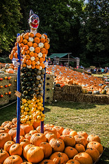 Stilted (Melissa Maples) Tags: ludwigsburg germany europe nikon d5100   nikkor afs 18200mm f3556g 18200mmf3556g vr residenzschloss palace blhendesbarock garden summer krbisausstellung pumpkins pumpkin festival sculpture art circus clown stilts