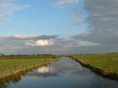 cloudy water (achatphoenix) Tags: water waterscape wasser eau aqua eastfrisia ostfriesland view bridge road roadtrip rheiderland rural reflection spiegelung autumn sky clouds nuages