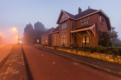 An old train station called 'Oosteinde' (1915-1972) at daybreak in the morning fog. (sandergroffen) Tags: aalsmeer building foggy hesm holland misty netherlands streetlamps streetlights trainstation auction flower historical monument old railroad noordholland nl