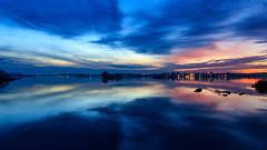 After sunset (Cajofavi) Tags: kalmar sweden sky water coast clouds dusk bluehour landscape reflection evening nature
