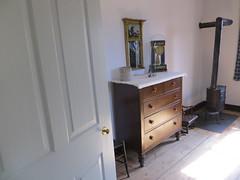 Chest of drawers, clock, and stove (Joel Abroad) Tags: oldsalem northcarolina johnvogler silversmith watchmaker house workshop dresser clock stove