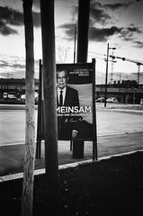 """""""Einsam"""" elections (thomasmika225) Tags: monochrome blackandwhite noiretblanc sw bw vienna austria street streetphoto urban thomasm leica leicam4p film analog kodak elections"""