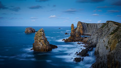 Layers of time (TanzPanorama) Tags: nature europe europa spain coast coastline cantabria costacantabrica costaquebrada blue bluehour le tanzpanorama liencres losurros fe1635mmf4zaoss sel1635z sony sonya7ii seascape landscape rock rockformation cliff ng cantabriansea geology koodfilter ndfilter 4stopndfilter layers time seaerosion flickr atmosphere sonyvariotessartfe1635mmf4zaoss