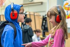 Ear Protection (evilpeacock) Tags: hearingprotection stemnight sanisloelementaryschool girl sevenyearold kids boy pointing gabrielpeacock jaidan