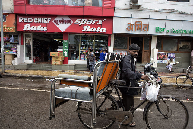 Transporting a Sofa by Bicycle