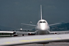 747 waiting in line, Hong Kong airport (1982) (Duncan+Gladys) Tags: hk hongkong enhanced