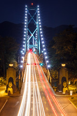 Lions Gate Bridge at Night Vancouver (Patrick Lundgren) Tags: ocean park city travel bridge blue trees light red sea sky urban white mountain canada blur mountains west cars tourism nature water wall night vancouver canon dark stars landscape photography lights star site twilight aperture gate long exposure downtown cityscape traffic suspension tripod north lion trails grouse first sigma landmark columbia historic national shore stanley transportation lions 1750 inlet british burrard streaks narrows 60d