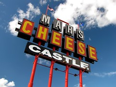 Mars Cheese Castle sign (SchuminWeb) Tags: road county sky mars signs chicago castle sign cheese wisconsin architecture clouds store ben cloudy flag web side letters july tourist flags tourists novelty signage letter lettering roadside grocery stores groceries wi signing traps trap array specialty partly chicagoland kenosha 2013 schumin schuminweb