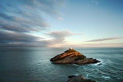 Light on Mumbles Lighthouse (Jo Evans1 - off and on for a while) Tags: light sea lighthouse swansea clouds island rocks gower mumbles rough top20lh20