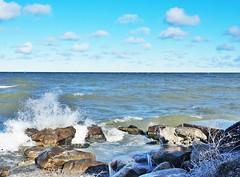 Lake Ontario (1) (Rev. Evan Clark) Tags: winter sky lake cold ice clouds rocks wave lakeontario