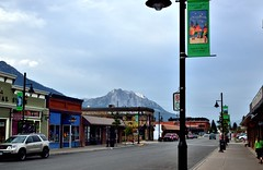 Small Town Streets of Fernie (thor_mark ) Tags: canada mountains streetlights britishcolumbia cities overcast urbanexploration storefronts day4 citycenter fernie project365 ferniebc colorefexpro mounthosmer nikond800e mountainsoffindistance eveningwalkaroundfernie fernieliverytransferco southfacingcliffs