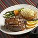 Center cut filet, seasoned and grilled to your liking topped with a light demi glaze.