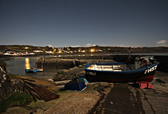 Coverack Harbour by Moonlight (Raphooey) Tags: uk light shadow sea england cloud moon fish west reflection beach st rock wall night clouds canon reflections stars boats eos lights star evening pier boat seaside fishing sand rocks long exposure cornwall shadows fishermen harbour cove jetty south tide low seawall lizard moonlit gb moonlight peninsula seashore slipway coverack 60d keverne meneage soutrhwest