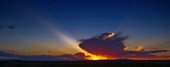Prairie Sunburst (Tom Herlyck) Tags: blue sunset red sky mountains clouds spring amazing colorado cloudy elements sunburst prairie sunbeam pikespeak crepuscularrays godbeams pueblocolorado elements8 nepesta