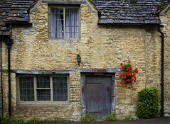 Austensibly Jane VI: A change of heart (chris.ph) Tags: door architecture geraniums red flowers building castlecombe window stonework england janeausten canon6d ef24105mmf4lisusm