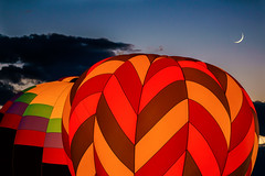 Night Glow and a Cresent Moon (tltichy) Tags: usa albuquerque balloon balloons blue cresent dusk evening festival fiesta glow green hotairballoons international moon newmexico night nightglow orange outdoors red southwest travel twilight