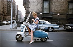 Central Park West & 72nd Street, 1965. (michaeldonovan22) Tags: newyorkcity nyc 1965 lambretta scooter summer daytime youngwoman sundress joelmeyerowitz safe snapshot manhattan michaeldonovan michaeldonovan22 thedakotaapartments