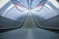 Way Up (CoolMcFlash) Tags: escalator moving stairs stairway movingstaircase symmetry urban underground subway vienna austria architecture longexposure perspective pov lowangleview leadingline city canon eos 60d rolltreppe symmetrie symmetrisch stadt ubahn wien sterreich architektur langzeitbelichtung blickwinkel fluchtpunkt fotografie photography sigma 1020mm 35 karlsplatz tube rhre modern reflection spiegelung