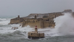 The weather has changed... (kurjuz) Tags: fortricasoli malta valletta breakingwaves breakwater gale grigal harbour heavyseas lantern roughsea waves windy