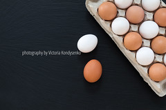 White and brown chicken eggs on black background (victoria.kondysenko) Tags: eggs tray bird white brown organic products chicken breakfast dieting box nature row eat healthy freshness diet ingredient eggspackage boiled food black stone
