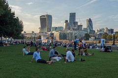 Last days of summer (Spannarama) Tags: london uk thames river skyline cityscape people grass sitting afterwork cityworkers walkietalkie gherkin cheesgrater tower42 southbank morelondon blueskies
