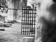 Arbroath abbey (frankhimself) Tags: arbroath abbey monks monastry ruin stone red black white bw gate entrance exit metal iron cast cemetary