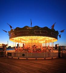 Carousel on Brighton Pier (Carol Spurway) Tags: brighton dusk sunset pier thebrightonmarinepalaceandpier palacepier brightonpier brightonpalacepier bluehour carousel horses fairground