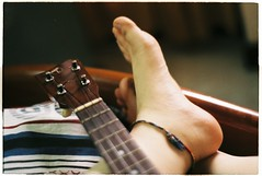 The human and the strings. (★ Chicz Chuot ★) Tags: music strings ukulele film analog analogue nikon nikonian fm2 fujifilm indoor 35mm saigon vietnam