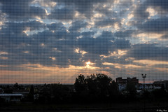 attraverso la zanzariera (Clay Bass) Tags: 27mm saluzzo backlight clouds fuji grid jpg natural rays sky sunrise xm1