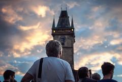 watching the drama unfold (ewitsoe) Tags: sunset sky people sun storm man building tower clock beautiful architecture 35mm spectacular nikon prague watch watching praha praga czechrepublic oldtownsquare starmsto d80 ewitsoe