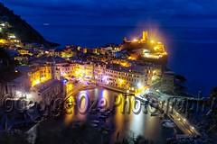 High Angle View of Vernazza at Night, Cinque Terre, Liguria, Italy (George Oze) Tags: sea night marina outdoors harbor timelapse colorful mediterranean illumination churchtower coastal cinqueterre lit vernazza historictown houseexteriors coastallandscape laspeziaprovince cinqueterrenatioonalpark