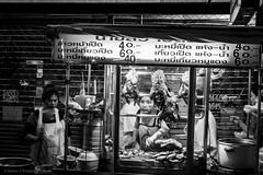 Chinatown street vendor - Bangkok (Nathan A Rodgers) Tags: newyorkcity travel blackandwhite bw usa thailand asia southeastasia chinatown bangkok streetphotography countries streetfood streetscenes 2012 travelphotography yaowarat