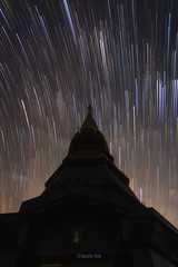 Star Trails Long Exposure At Night (Natthawat Jamnapa) Tags: blue trees summer sky motion blur mountains nature beautiful beauty lines rain vertical night canon dark wonder landscape thailand shower star evening pagoda twilight colorful long exposure solitude glow earth background space north meadow trails peaceful science pole hills clear astrophotography zen rotation chiangmai astronomy serene colourful polar universe pure starry tranquil meteor startrails 6d