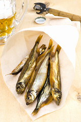 Mug of beer with smoked fish (gorobina) Tags: sea food white fish industry cooking cup scale nature water beer animal yellow fog dinner mouth studio lunch mackerel gold one golden healthy fishing market drink eating background fat smoke traditional tail gourmet salty mug seafood kipper appetizer preserved fin cod isolated herring protein staple refreshment ingredient salted palatable nourishing