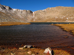 Summit Lake below Mount Evans, Colorado (Batikart) Tags: park travel flowers blue schnee autumn light vacation sky plants usa sun mountain lake holiday snow mountains green fall ice nature colors yellow america canon landscape geotagged see frozen evans colorado holidays frost unitedstates urlaub herbst nat