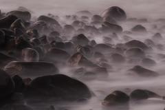 Pebbles on a beach (Julian Pett) Tags: sea beach water rocks long exposure waves pebbles porlock mygearandme mygearandmepremium mygearandmebronze mygearandmesilver mygearandmegold mygearandmeplatinum mygearandmediamond