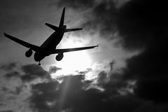 approaching (stese182) Tags: sun white black plane canon eos final backlit approach planespotting 600d avgeek