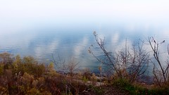 Lake from the Bluffs (Mike Nitsopoulos Photography) Tags: lake sky clouds fog vanishingpoint fall autumn scarborough toronto ontario canada lakeontario bushes trees shore blue green yellow branches ripples waves rocks path white bluffs scarboroughbluffs guildwood park hike