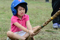 Not Having Fun 2 (Bob Hawley) Tags: people children palmfronds asia kaohsiung zuoying taiwan nikond7100 nikon80200f28 aborigines aboriginalculture festivals races crying portraits
